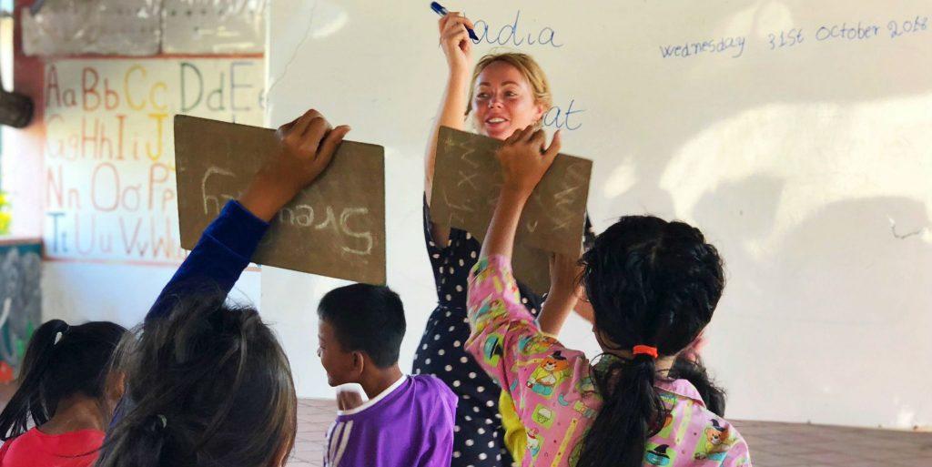 Build up your empathy by volunteering with children in schools