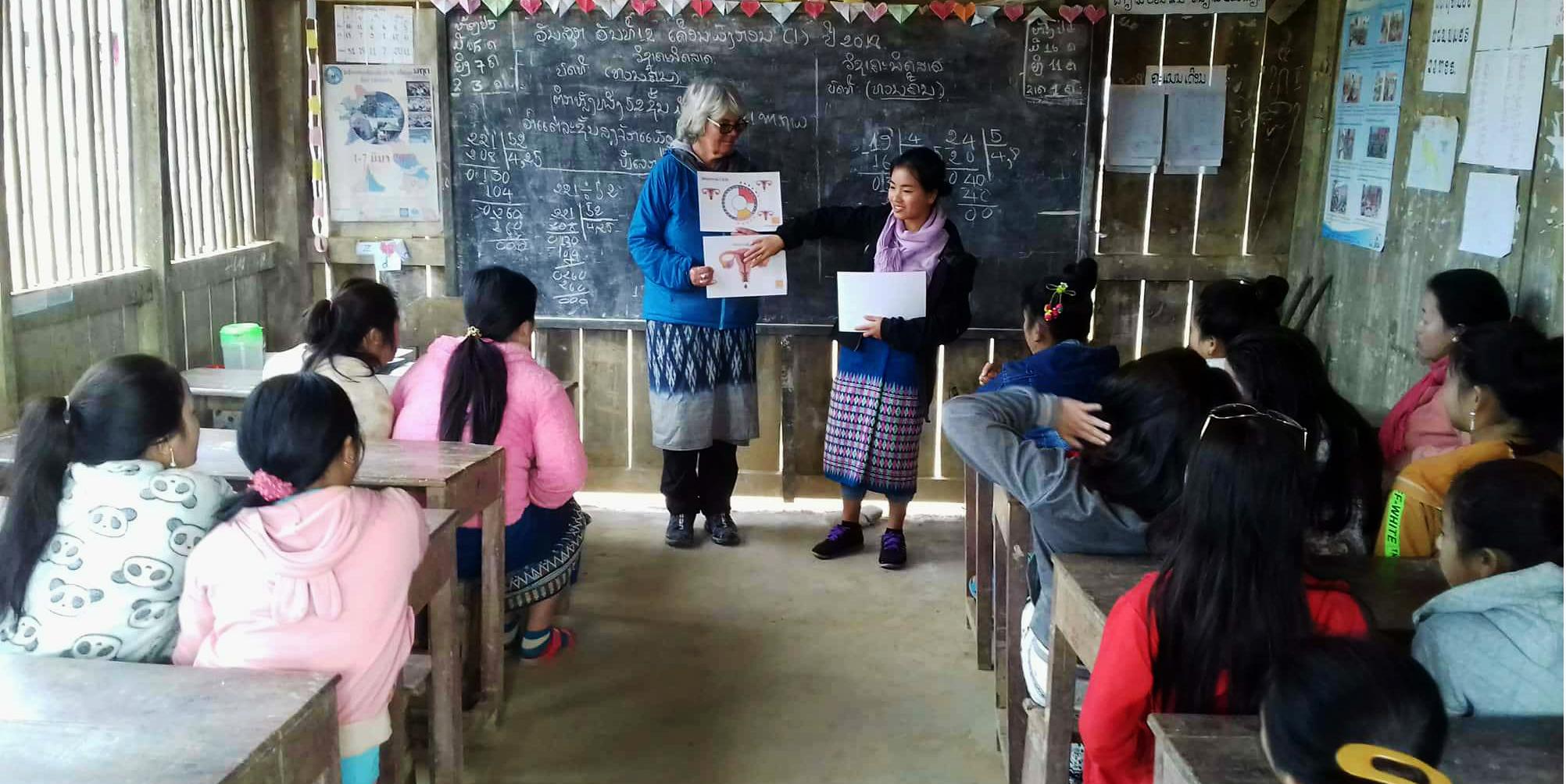 volunteer leading women's health classes on a short-term volunteering program
