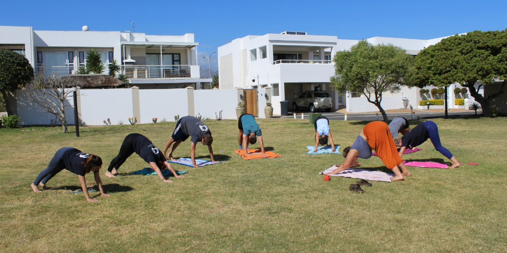 GVI volunteers doing yoga on base.