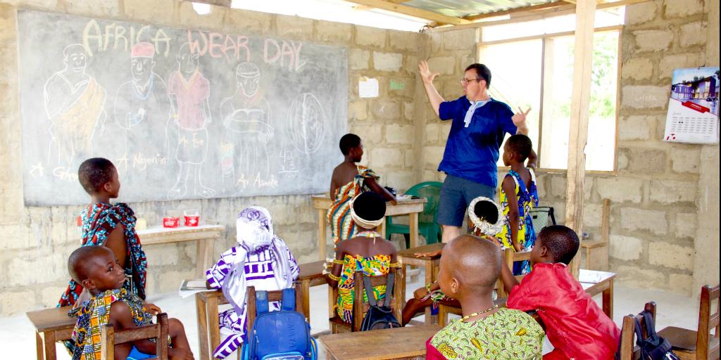 A volunteer teaching a class of children in Ghana.
