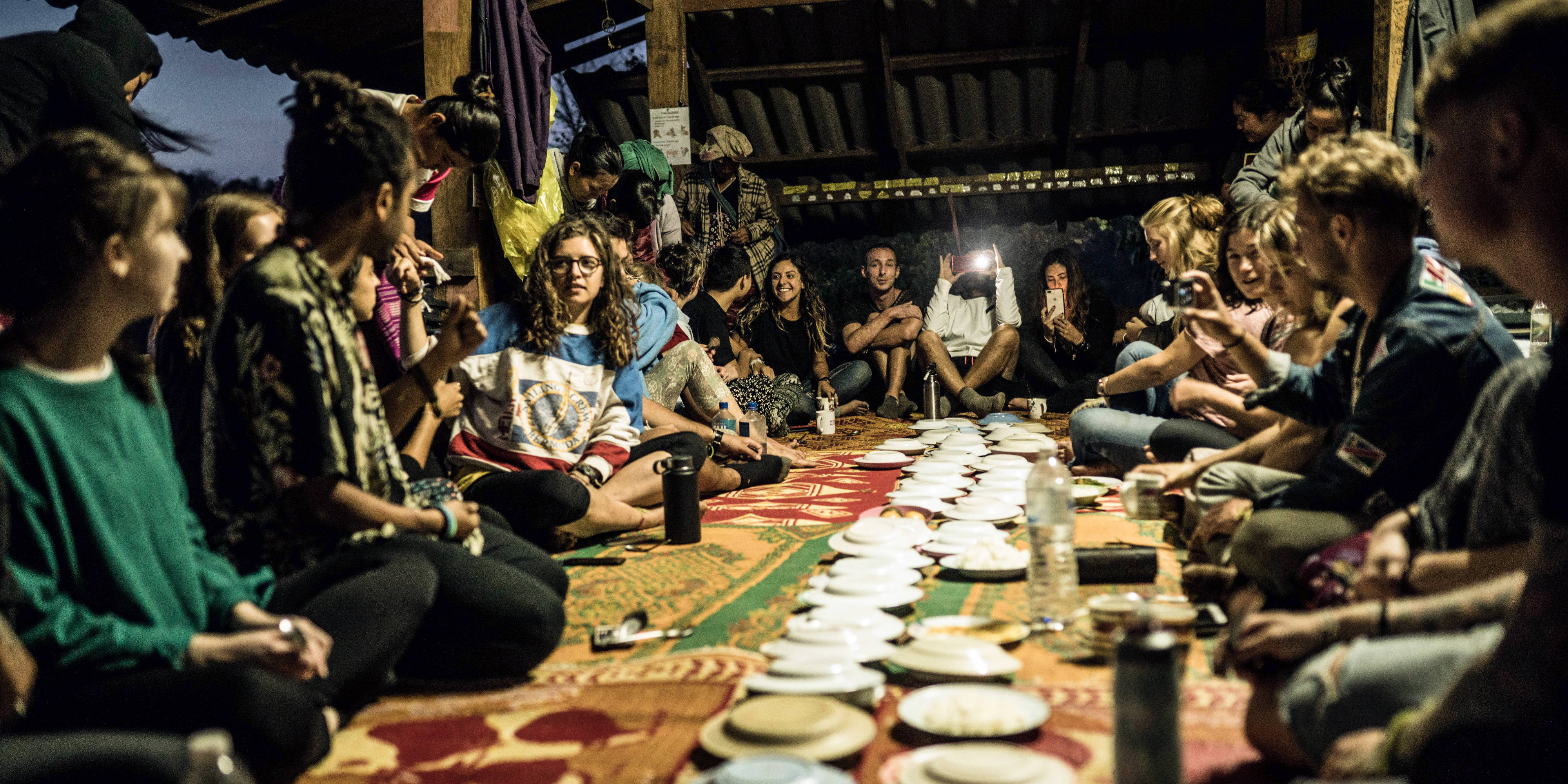 Paying to volunteer with GVI means that all your food and accommodation will be covered. Pictured: GVI volunteers share a meal in the Chiang Mai base.