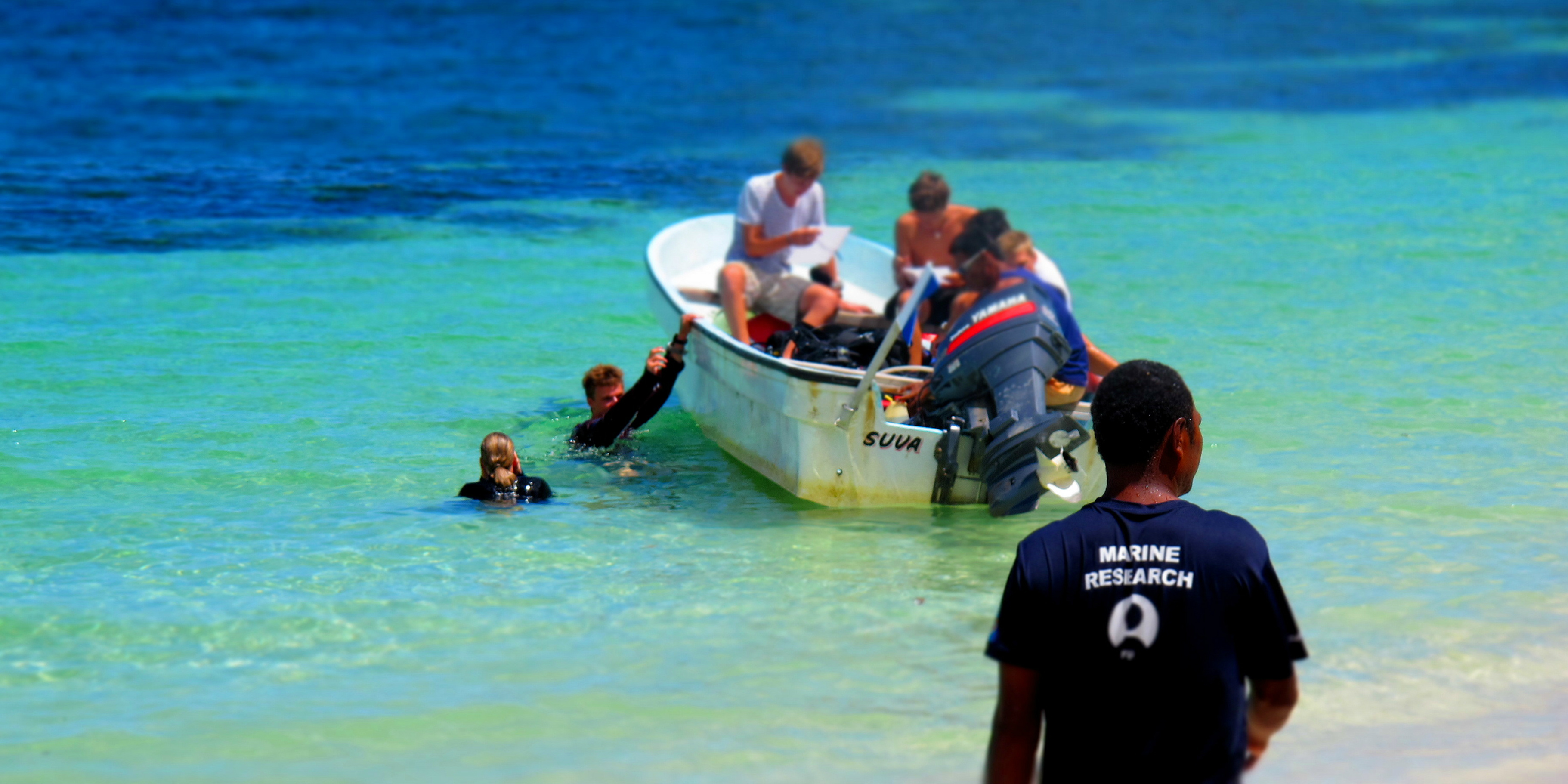 GVI participants head out to dive, as part of earning their PADI advanced open water.