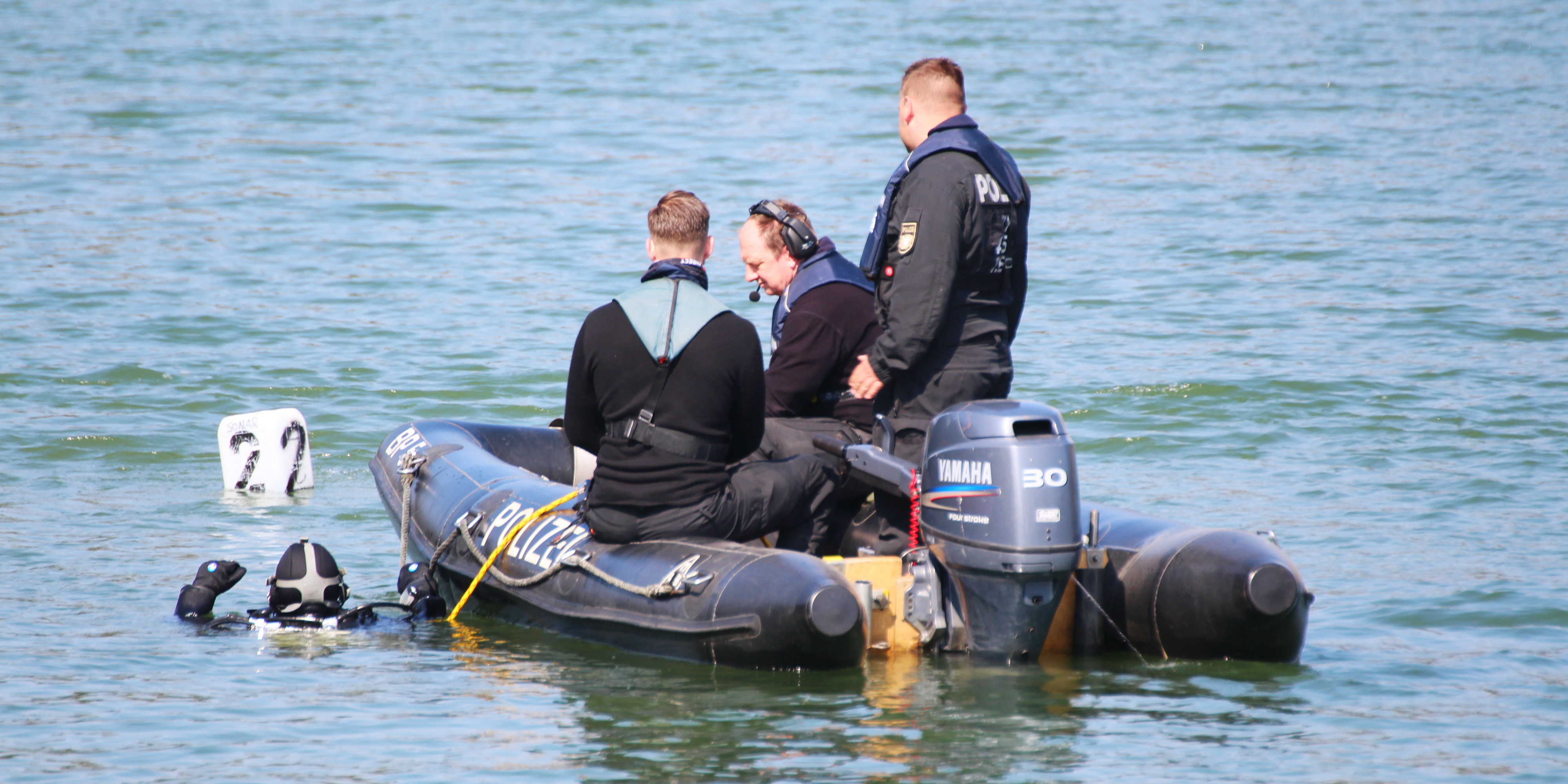 A PADI professional diver helps to assist in a police investigation. This is one of may jobs that involve scuba diving.