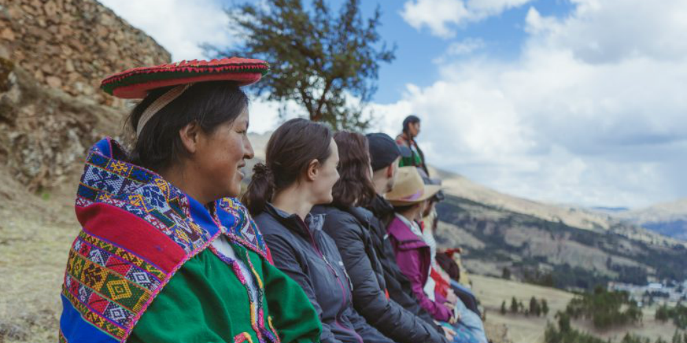 Participants enjoy a view of the Sacred Valley in Peru . Experiences like this is one of the many pros of taking a career break.
