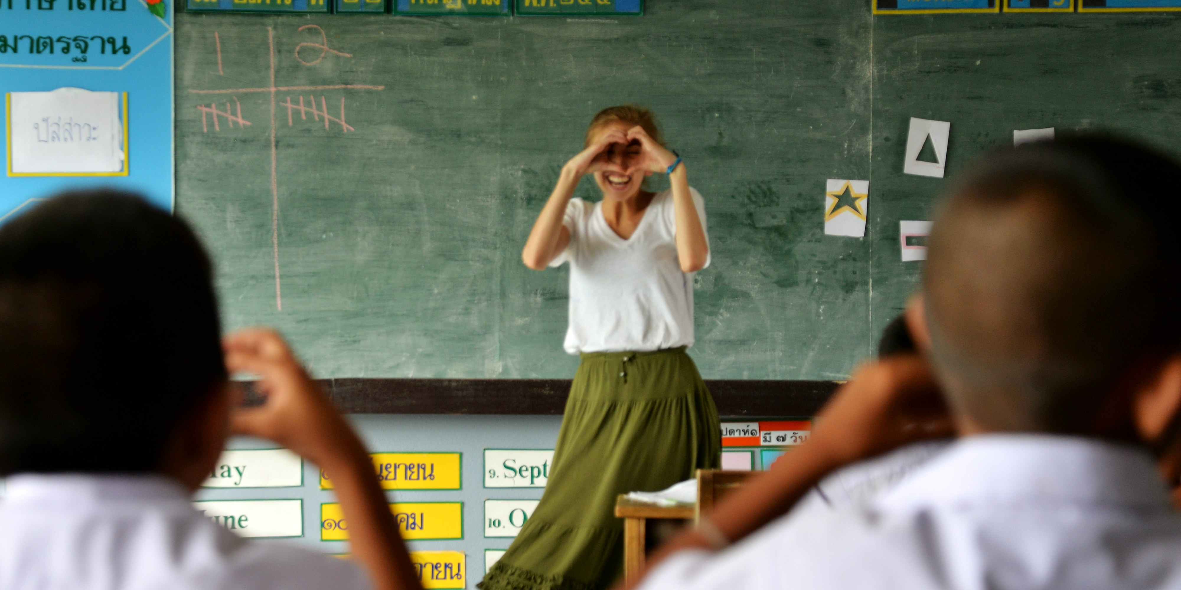 A volunteer puts their TEFL certification to good use in a lesson on shapes.