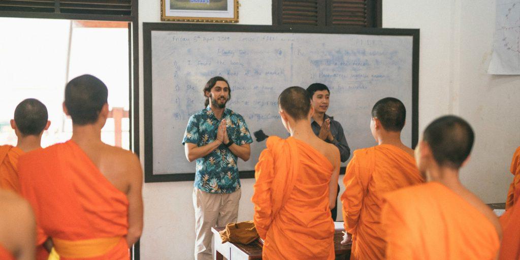Teach novice Buddhist monks in Laos