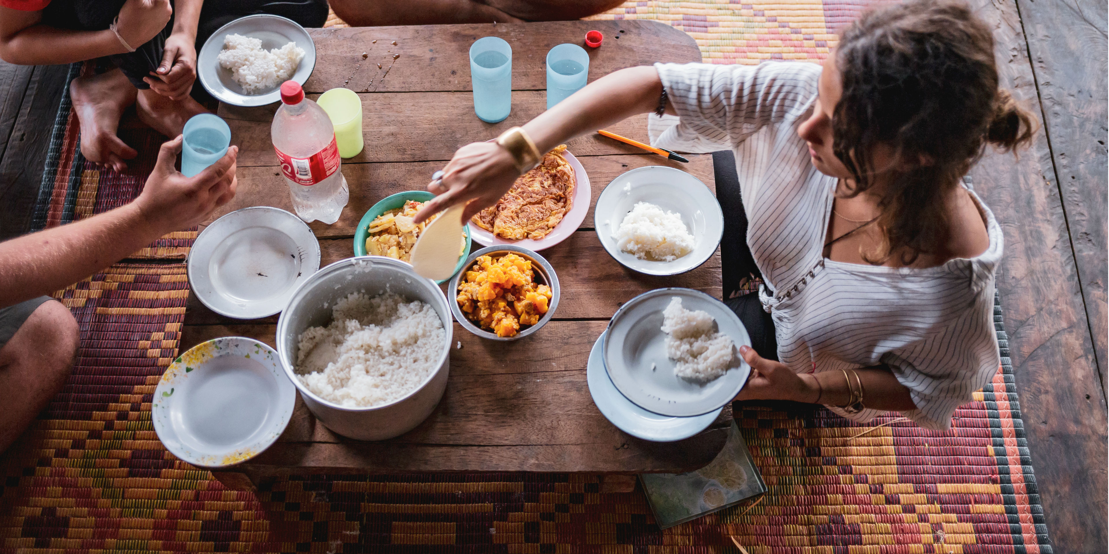 GVI participants in Chiang Mai enjoy a vegetarian meal together, in between their efforts volunteering with elephants.
