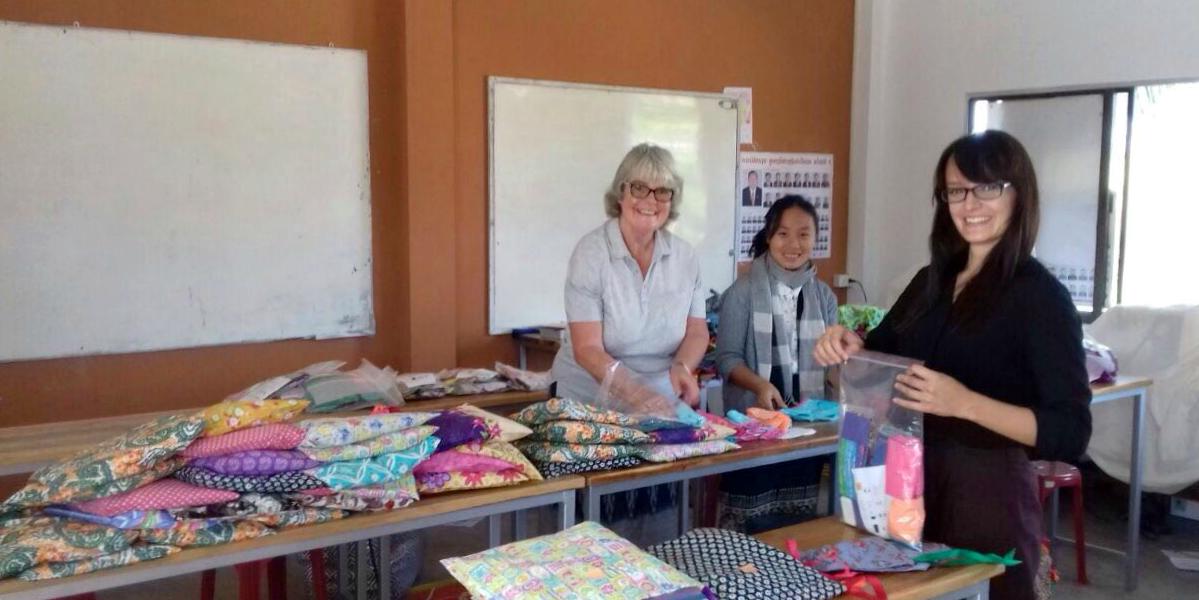 GVI participants prepare menstrual health kits as part of the women's empowerment program in Laos.