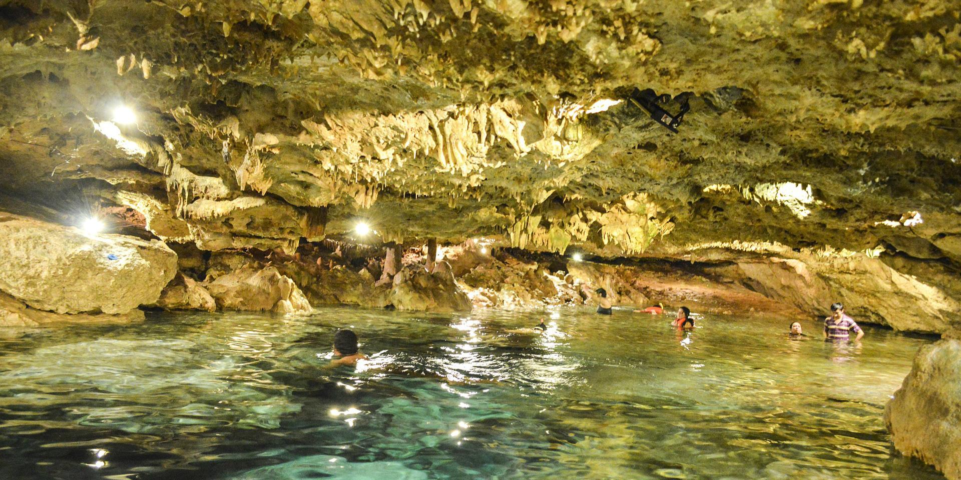 Go swimming in a Ceynote in Puerto Morelos, Mexico