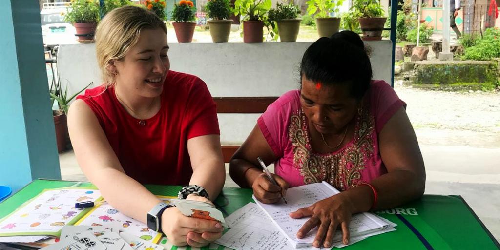 GVI volunteer teaching women
