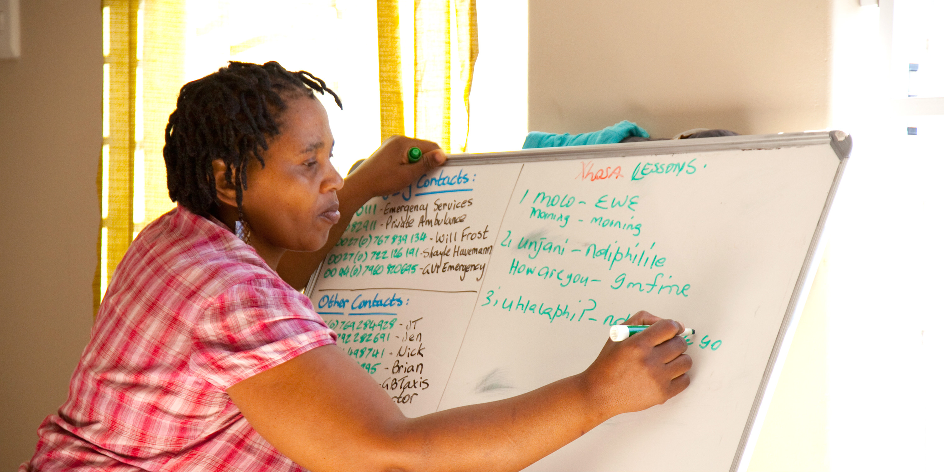 A woman takes part in empowerment workshops facilitaties by gap year volunteers.