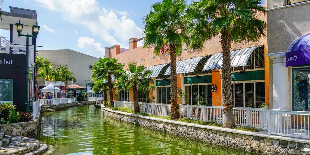 Shops surrounding a canal in Cancun