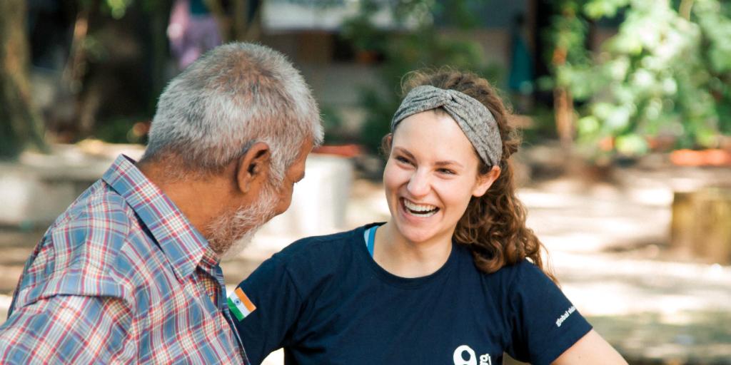 A volunteer speaking to an Indian man