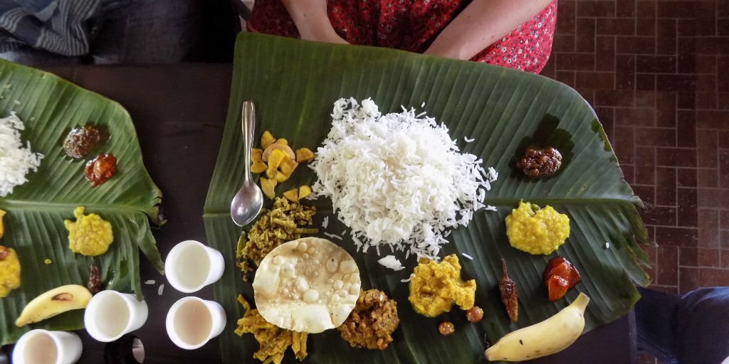 Traditional Indian food served on a banana leaf