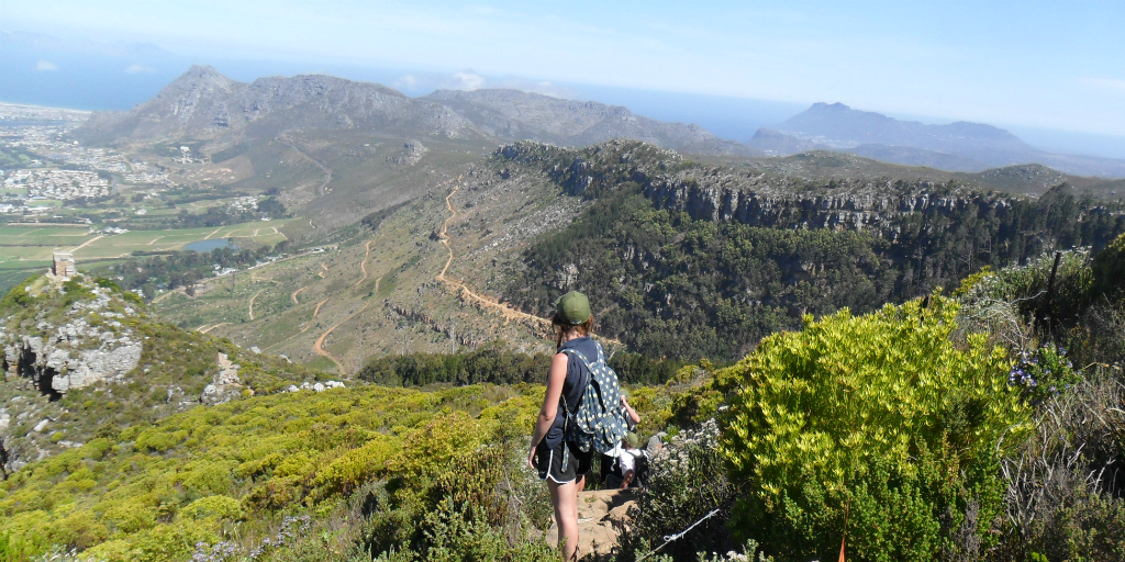 A GVI volunteer looking out over the landscape from a mountainside in Cape Town, South Africa.