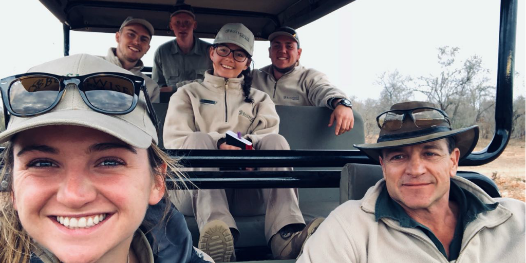 Volunteers in a safari vehicle with a Bushwise staff member.