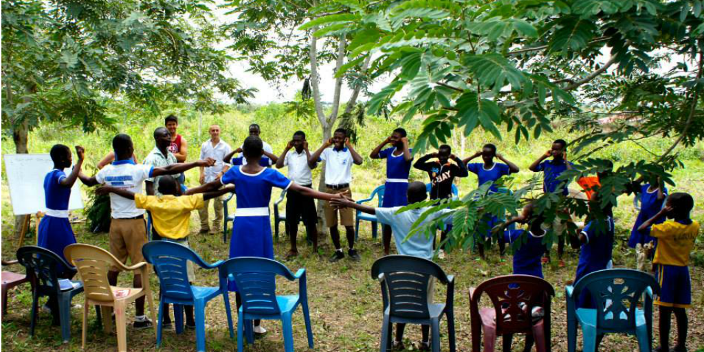 A group session in Ghana taking place in the forest.