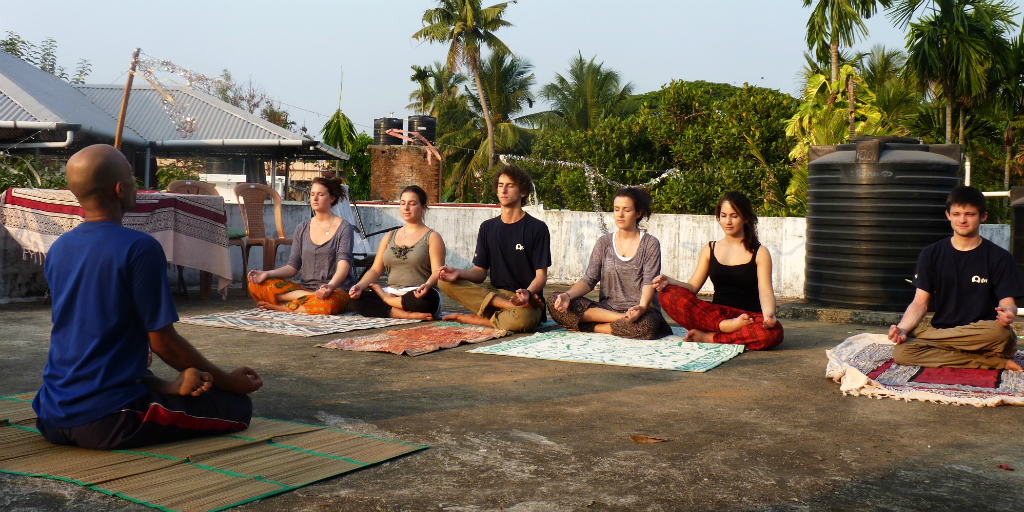 Try meditative yoga in Kochi India.