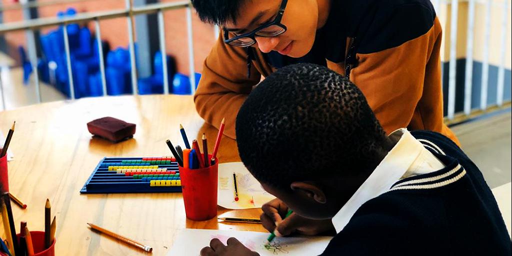 Teach English abroad on a volunteer program.