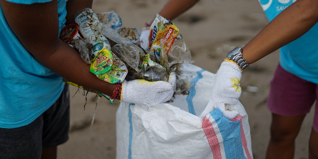 volunteers taking part in a beach cleanup